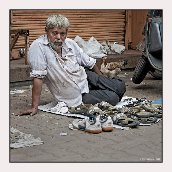 "3rd year Pic 078 - Oct 11 2010<br /> Footwear! <br /> <br /> Chor Bazaar, located near Bhendi Bazaar in South Mumbai, is one of the largest flea markets in India. The word Chor means ""thief"" in Hindi-Urdu. The reason it is known as ""thief's market"", is because it assumed that goods sold there are stolen. There's a saying about this area, if you lose anything in Mumbai you can buy it back from the ""chor bazaar""! Most of proper shops are closed on Friday as this area is in the heartland of one of the largest Muslim populations in Mumbai.<br /> <br /> Chor Bazar is a maze of streets with shops that look like musty attics and sell just about anything at bargain prices from old ship parts, grandfather clocks, gramophones, to crystal chandeliers and old English tea sets antiques at throwaway prices, including colonial-era lamps, Art Deco clocks and trinkets of every kind. It's not an easy job to shop here as one has to rummage through a lot of stuff, including junk and then set about bargaining.<br /> <br /> <br /> B&W version   <br />  <a href=""http://hershy.smugmug.com/Photography/Mumbai-my-city/Chor-Bazar/13961726_aijBD#1025993135_rnkuw-A-LB"">http://hershy.smugmug.com/Photography/Mumbai-my-city/Chor-Bazar/13961726_aijBD#1025993135_rnkuw-A-LB</a><br /> <br /> <br />  <a href=""http://en.wikipedia.org/wiki/Chor_Bazar"">http://en.wikipedia.org/wiki/Chor_Bazar</a>"