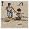 """3rd year Pic 204 - Apr 13 2011<br /> Kabbadi<br /> Chowpatty<br /> <br /> Kabbadi is a team contact sport that originated in South Asia BCE, as a form of recreational combat training.[1] Two teams occupy opposite halves of a field and take turns sending a """"raider"""" into the other half, in order to win points by tagging or wrestling members of the opposing team; the raider then tries to return to his own half, holding his breath and chanting """"kabaddi, kabaddi, kabaddi"""" during the whole raid. The name — often chanted during a game — derives from a Tamil word meaning """"holding of hand"""", which is indeed the crucial aspect of play. It is the national game of Bangladesh and the state game of Tamil Nadu, Punjab and Andhra Pradesh in India.<br /> <br /> <a href=""""http://en.wikipedia.org/wiki/Kabbadi"""">http://en.wikipedia.org/wiki/Kabbadi</a>"""