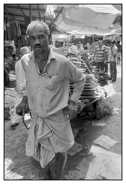 "3rd year Pic 256 - Jun18 2011 <span style=""color:yellow"">Handcart puller</span>  Jyotiba Phule Mkt. (Crawford Mkt. )  This person was carrying wooden & cardboard boards on his handcart.  <span style=""color:cyan"">response to some comments </span> Fotomom, yes tiring work for sure but it also was a hot and humid day and my friends and I were drenched after our shoot!  Linda, handcart pullers carry load for others, here he may have been taking the boards of crates and boxes from a fruit dealer to a scraps dealer.  Gail, the weather is hot and humid here and of course the rains! During the monsoon months of Jun-Sept Mumbai gets an average of 100"" of rains!   Colour version is here: <br> http://hershy.smugmug.com/Photography/Mumbai-my-city/South-Mumbai/16667060_gC4gZV/1342369306_2rkzPMr#1342367742_6hMBm6f-A-LB"