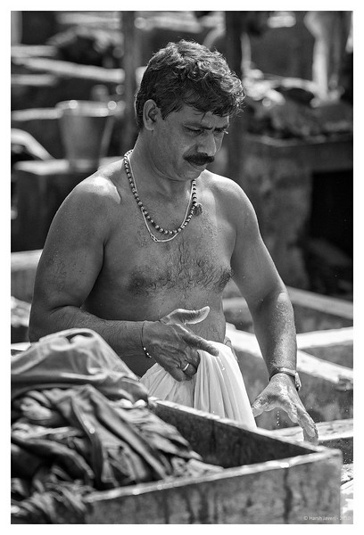 "3rd year Pic 109 - Nov 11 2010<br /> Immersed in work<br /> Dhobi Ghat<br /> <br /> ADDED IN RESPONSE TO SOME QUERIES: <br /> <br /> Dhobi Ghat is washers' area in Mumbai. The washers known locally as Dhobis work in open to wash the cloths from Mumbai's homes, hotels and hospitals. There are row upon row of open-air concrete wash pens, each fitted with its own flogging stone. There are quite a few Dhobi Ghats in Mumbai, prominent amongst them are Mahalakshmi & Cuffe Parade. <br /> <br /> <br /> colour version is here:   <br />  <a href=""http://hershy.smugmug.com/Photography/Mumbai-my-city/Dhobi-ghat-cuffe-Parade/10119943_4urML#1009751562_9viYs-A-LB"">http://hershy.smugmug.com/Photography/Mumbai-my-city/Dhobi-ghat-cuffe-Parade/10119943_4urML#1009751562_9viYs-A-LB</a>"