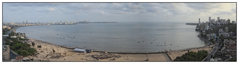3rd year Pic 216 - Apr 30 2011<br /> Chowpatty & marine drive <br /> <br /> Pano from 12 images shot with D700 24-85mm. <br /> Best seen in Origial size.<br /> <br /> The beach in foreground is known as Girgaum Chowpatty beach from where I've taken quite a few pictures.  Left of the beach is Marine drive. In the olden days of gas lights, the circular road used to twinkle in the dark and hence it became famous as the Queen's necklace. The cluster of buildings on right is known as Walkeshwar and ends with the Governor's residence at the end.<br /> Shot from 20th floor terrace of Sarathi building