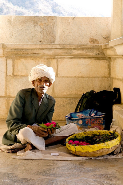 3rd year Pic 013<br /> Flower vendor<br /> <br /> This old man was selling flowers outside Ranakpur temple. I liked the morning light adding a soft touch to his weathered face... <br /> Best seen in large size.