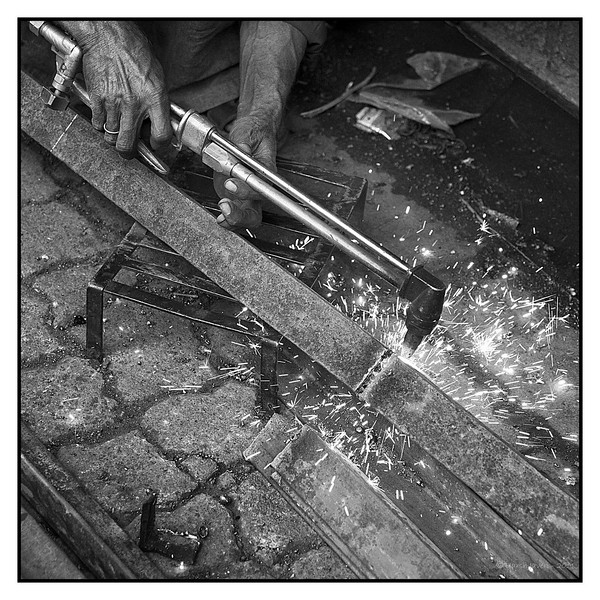 "3rd year Pic 150 - Feb 04 2011<br /> Strike when the iron... <br /> Kumbharwada, Mumbai<br /> <br /> Colour version is here , couldn't decide which to put here..  what's your opinion?   <br /> <br />  <a href=""http://hershy.smugmug.com/Photography/Mumbai-my-city/Kamathipura-Kumbharwad/15310394_rtE3U#1160610769_gRafT-A-LB"">http://hershy.smugmug.com/Photography/Mumbai-my-city/Kamathipura-Kumbharwad/15310394_rtE3U#1160610769_gRafT-A-LB</a>"