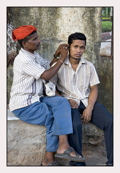 3rd year Pic 100 - Nov 02 2010<br /> Ear cleaning! <br /> <br /> A special service is offered to clean the ears with wax thinning oils and other ointments. In big - modern cities they are seen only in the old / poor areas or crowded areas like railway stations or temples but are quite common in small towns and villages. <br /> <br /> near Victoria Terminus (VT) Station, now known as Chatrapati Shivaji Terminus (CST)
