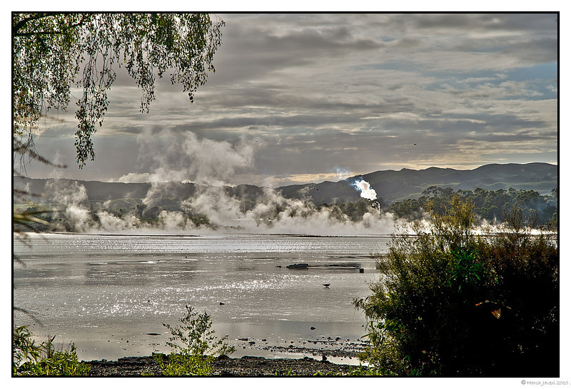 "3rd year Pic 250 - Jun11 2011 <span style=""color:yellow"">Steamy Morning</span>   Thank you all for your comments on yesterday's picture of morning at Rotorua lake. This picture shows the steam rising at 6.30 in the morning. Even at this early hour the light was very bright at places.   <span style=""color:red"">BEST SEEN IN ORIGINAL SIZE </span> <br> <span style=""color:cyan"">For more pictures of Rotorua go to  </span> <br> http://hershy.smugmug.com/Travel/New-Zealand-Macau-Hong-Kong/Rotorua/15128440_rKfDQ<br> Rotorua: http://en.wikipedia.org/wiki/Rotorua<br> Rotorua: http://www.rotoruanz.com/"
