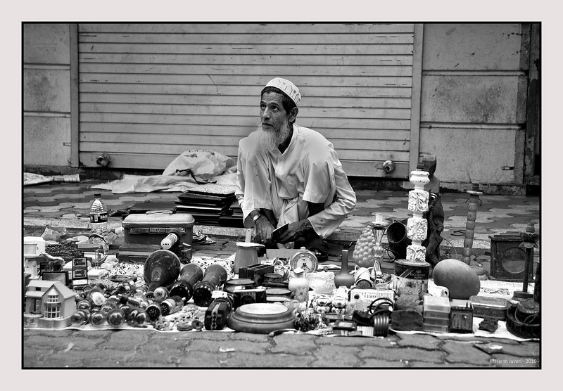 "3rd year Pic 088 - Oct 21 2010<br /> Take your pick!  Chor Bazar<br /> BEST SEEN IN LARGE SIZE<br /> <br /> This person was selling a whole lot of stuff, valves, vanity bag, clocks, table lamps, figurines and other stuff!<br /> Original colour version is here:<br /> <br />  <a href=""http://hershy.smugmug.com/Photography/Mumbai-my-city/Chor-Bazar/13961726_aijBD#1033580538_FjagE-A-LB"">http://hershy.smugmug.com/Photography/Mumbai-my-city/Chor-Bazar/13961726_aijBD#1033580538_FjagE-A-LB</a>"