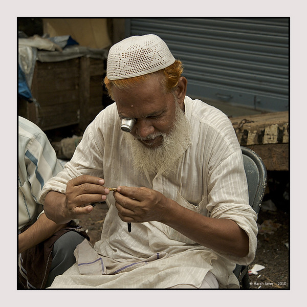 """3rd year Pic 085 - Oct 18 2010<br /> Watch repairer, Chor Bazar<br /> <br /> Muslims, men & women; often use henna to colour their hair and beards.  Yesterday's pic showed a henna dyed beard. <br /> <br /> One more pic is here:  <br />  <a href=""""http://hershy.smugmug.com/Photography/Mumbai-my-city/Chor-Bazar/13961726_aijBD#1044695804_gUBG7-A-LB"""">http://hershy.smugmug.com/Photography/Mumbai-my-city/Chor-Bazar/13961726_aijBD#1044695804_gUBG7-A-LB</a>"""