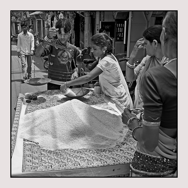 "3rd year Pic 067 - Sep 29 2010<br /> Daily rations<br /> <br /> Ladies buying daily ration of rice from this street vendor in Udaipur. <br /> <br /> Original colour version is here:  <br />  <a href=""http://hershy.smugmug.com/Travel/Udaipur/13681113_3xWax#1014702915_EDJ3t-A-LB"">http://hershy.smugmug.com/Travel/Udaipur/13681113_3xWax#1014702915_EDJ3t-A-LB</a>"
