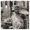 "3rd year Pic 110 - Nov 12 2010<br /> Stern...<br /> This lady at the Dhobi Ghat was gossiping with someone and noticed me and made a face...!!!<br /> To see the 1st pic go to    <br />  <a href=""http://hershy.smugmug.com/Photography/Mumbai-my-city/Dhobi-ghat-cuffe-Parade/10119943_4urML#983975918_krNfc-A-LB"">http://hershy.smugmug.com/Photography/Mumbai-my-city/Dhobi-ghat-cuffe-Parade/10119943_4urML#983975918_krNfc-A-LB</a><br /> <br /> <br /> Dhobi Ghat is washers' area in Mumbai. The washers known locally as Dhobis work in open to wash the cloths from Mumbai's homes, hotels and hospitals. There are row upon row of open-air concrete wash pens, each fitted with its own flogging stone. There are quite a few Dhobi Ghats in Mumbai, prominent amongst them are Mahalakshmi & Cuffe Parade.<br /> <br /> Colour version is here:   <br />  <a href=""http://hershy.smugmug.com/Photography/Mumbai-my-city/Dhobi-ghat-cuffe-Parade/10119943_4urML#984110694_yJGVA-A-LB"">http://hershy.smugmug.com/Photography/Mumbai-my-city/Dhobi-ghat-cuffe-Parade/10119943_4urML#984110694_yJGVA-A-LB</a><br /> original colour version is here:  <br />  <a href=""http://hershy.smugmug.com/Photography/Mumbai-my-city/Dhobi-ghat-cuffe-Parade/10119943_4urML#984110694_yJGVA-A-LB"">http://hershy.smugmug.com/Photography/Mumbai-my-city/Dhobi-ghat-cuffe-Parade/10119943_4urML#984110694_yJGVA-A-LB</a>"