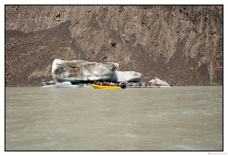 "3rd year Pic 231 - May 18 2011 <span style=""color:yellow"">Iceberg</span>  <span style=""color:silver""> Muller Glacier Lake, Mt.Cook, New Zealand </span>  The boat gives an idea of the size of the iceberg.   Best seen in large size.  <span style=""color:silver"">The Hermitage is located in Aoraki Mount Cook Alpine Village in the South Island of New Zealand. A spectacular 55km drive from the Lake Pukaki / State Highway 8 turn-off between Christchurch and Queenstown, the village lies deep within the Aoraki Mount Cook National Park and World Heritage area, surrounded by the silent splendor of the Southern Alps.  </span> <br> http://www.hermitage.co.nz  <span style=""color:red""> More pictures of Mt.Cook and Hermitage</span><br> http://hershy.smugmug.com/Travel/New-Zealand-Macau-Hong-Kong/Mount-Cook/15441914_ZWyHX"