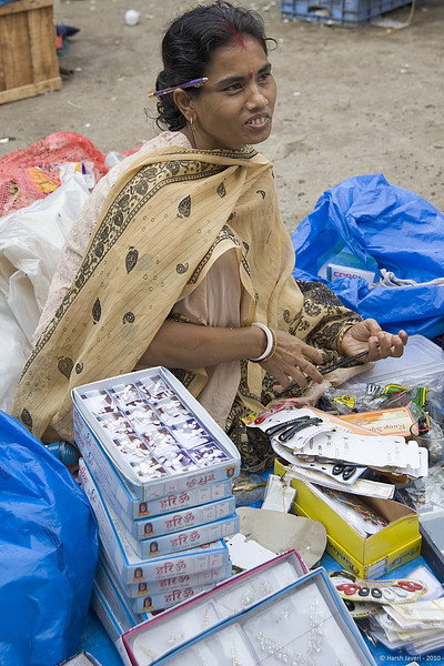 "3rd year Pic 004<br /> Trinkets lady<br /> <br /> Shot at Colaba market in South Mumbai.<br /> <br /> More pics of the market   <br />  <a href=""http://hershy.smugmug.com/Photography/Mumbai-my-city/Misc-shots-of-Mumbai/6410100_x8urE#927521927_tHmQU"">http://hershy.smugmug.com/Photography/Mumbai-my-city/Misc-shots-of-Mumbai/6410100_x8urE#927521927_tHmQU</a>"