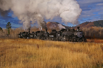 A re-created Rio Grande freight train departs the yard at Chama, New Mexico on a beautiful fall morning.