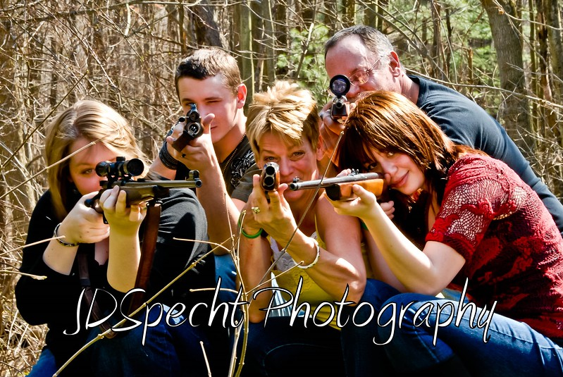 """OPEN SEASON!"" <br /> Ever have one of those days when you feel like you have a target on your head?<br /> A little fun with the Buzard Family at Sunday's shoot :)<br /> <br /> NOTE: no photographers were harmed during this ""SHOT"" :) the guns were personally check by me & hubby to be unloaded!<br /> <br /> Yea... I'll shoot anything or anyone that does not shoot me first :)<br /> Jilly"