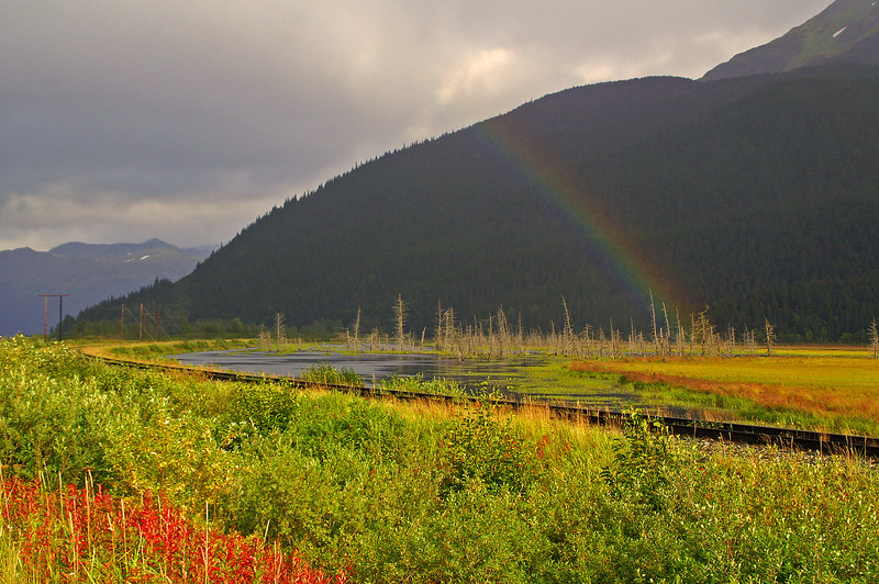 After a severe thunderstorm the sun pops out and a rainbow appears above the tracks near Portage, AK.