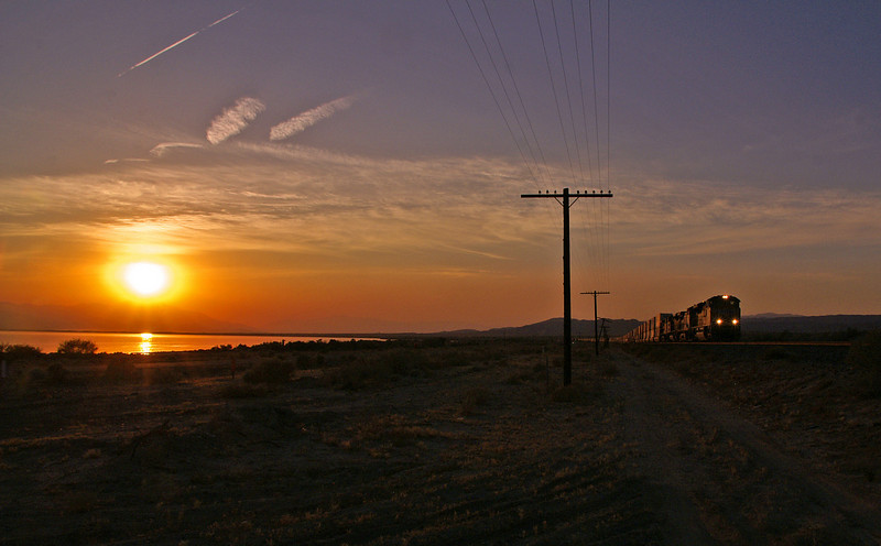 The sun sets on the Salton Sea as another train heads east with Asian commerce bound for eastern markets.
