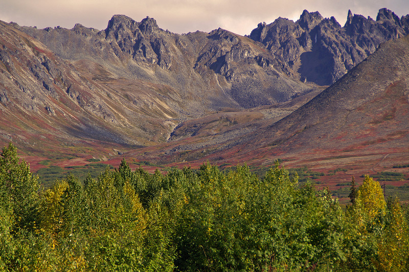 The small town of Hurricane, AK is surrounded by mountains in all directions.