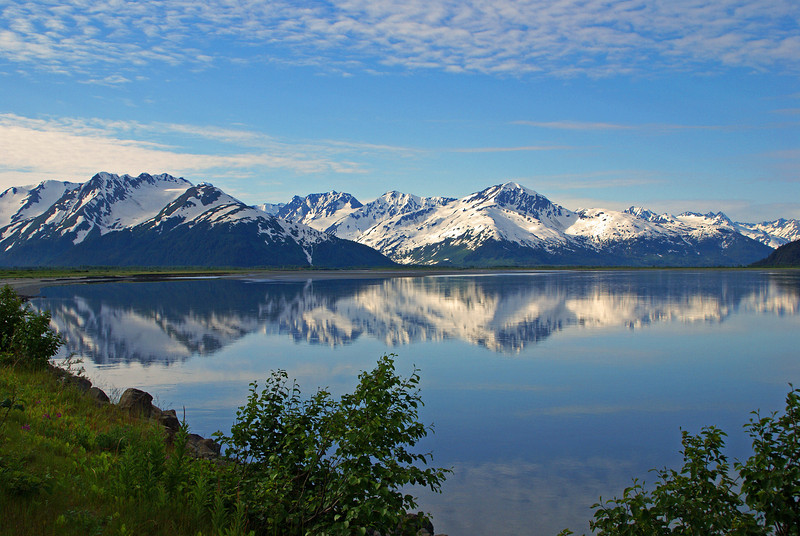 It is not often that one can get a reflection in the ocean but sometimes it is possible along Turnagain Arm near Portage, Alaska.