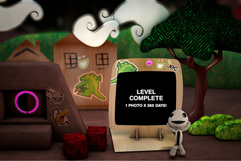 "day 365: ""level complete"". what started out as taking 1 photo a day for a month finally landed me here one year later. it was definitely worth the work as i look back at some cool memories. the image above is a composite of a photo of sackboy taken today along with the scene created in cinema 4D. the scene is based on the littleBigPlanet game for PS3 and took about a day to design and render. the stickers are illustrations i created in the past and added post. sackboy took me about 2 weeks to make and was created specifically for this shot. he has since been abducted by my daughter!"