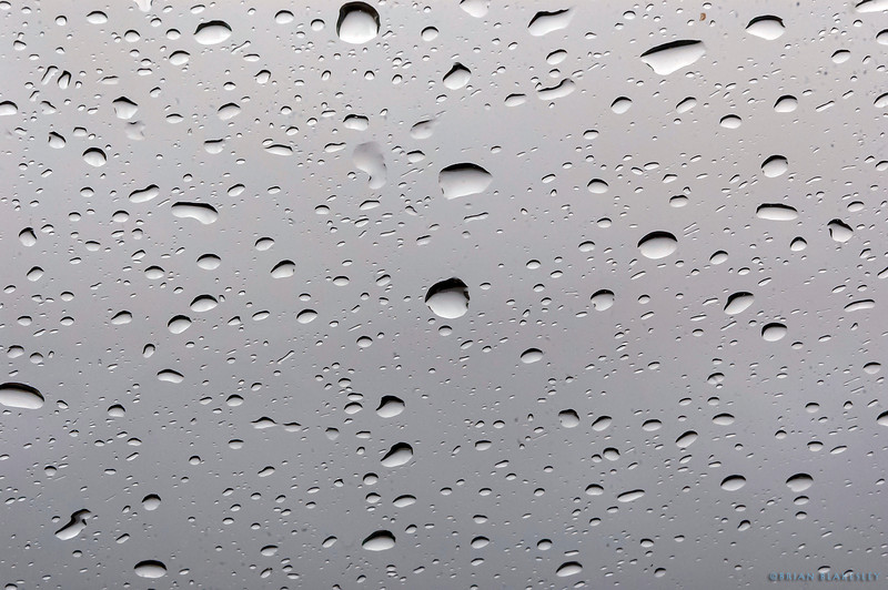 It's raining, it's pouring<br /> <br /> Water droplets on my windshield<br /> <br /> Taken 2012.03.18, Apache Junction, AZ, USA