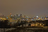 The St Paul skyline on a cold and dreary night. The white building on the right is the Minnesota state capital building. Taken from Indian Mounds Park.