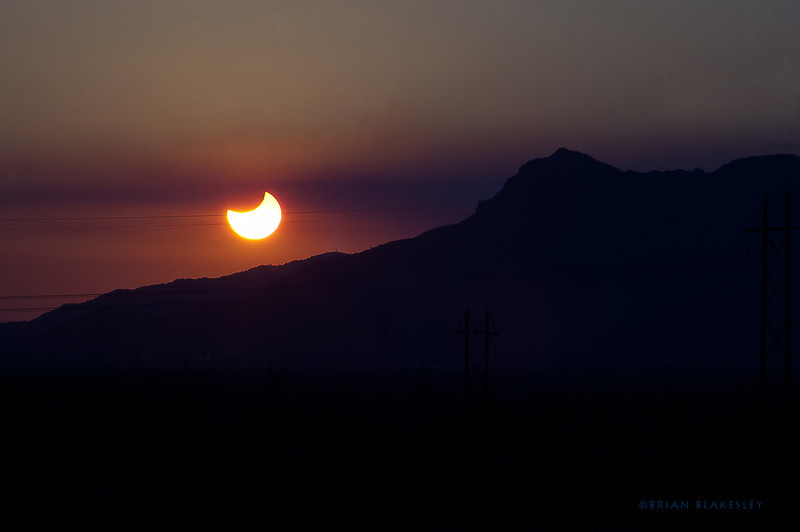 Annular Eclipse at sunset<br /> <br /> Forgot all my filters when I left home so I had to miss most of the fun, but I liked this one.<br /> <br /> Taken 2012.05.20, Apache Junction, AZ, USA