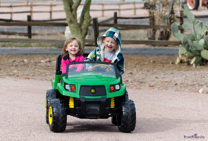 """Liam and Sophie having fun with their new """"tractor""""<br /> <br /> Taken 2012,12,25, Apache Junction, AZ, USA"""