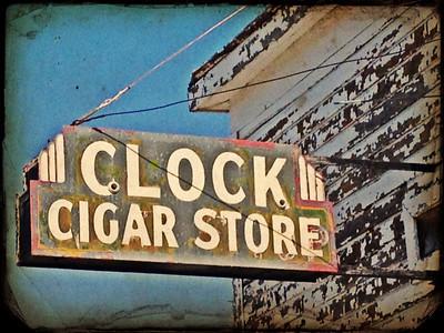 Clock, Cigar Store, antique sign in Mackay, Idaho. 9.12