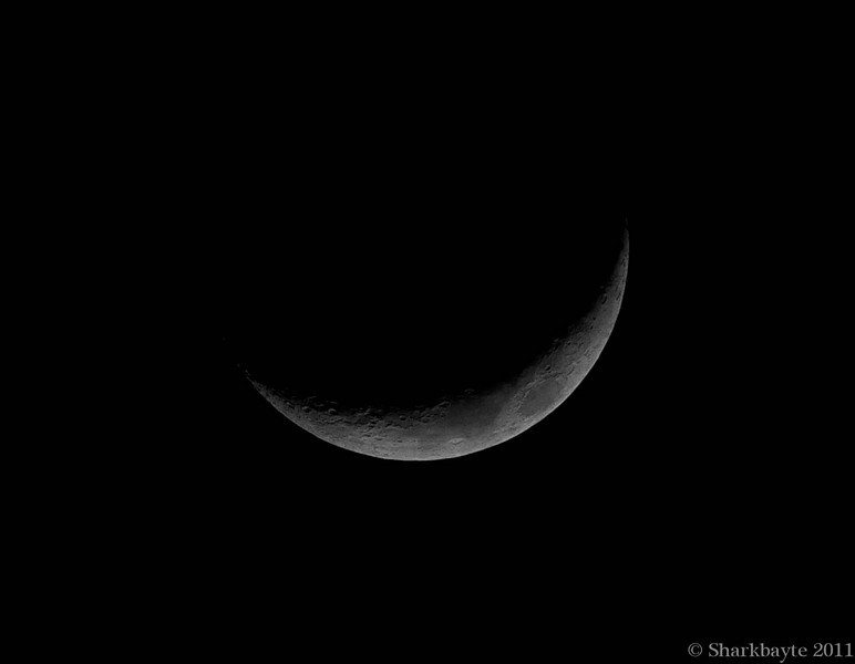 April 8, 2011-Waxing Crescent Moon, last night's moon was only four days old. I try to capture the moon as early as I can. I was trying for a two and three day old moon, but I wasn't able to with the weather conditions. So this is the earliest I can get for this cycle. (Day 98:365 @sharkbayte for daily Post)