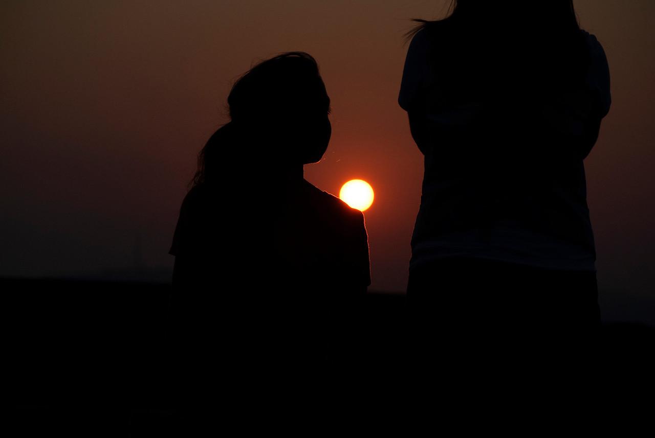 8-05-10  Rachel & Laura watching the sunset