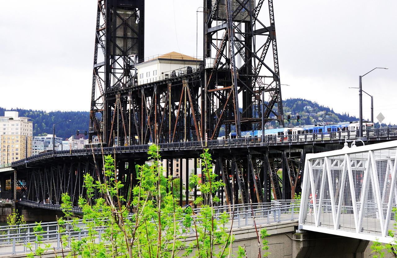 6-21-09  Steel Bridge, Portland (1912) 2-deck bridge with cars and light-rail on top deck, train tracks on lower deck.