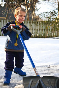 2010-03-01  My little helper clearing the ice and snow on the first day of March.