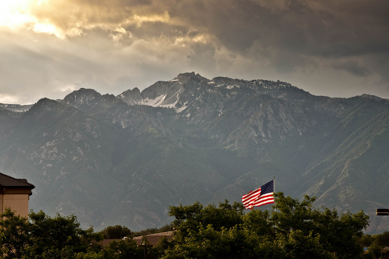 Land of the Free (7/2/2010)<br /> <br /> This is the view outside of my hotel window with the flag and the Wasatch Mountains I thought this appropriate for the on coming 4th of July weekend.  <br /> <br /> Hope you have a safe and fun weekend,<br /> -Bob