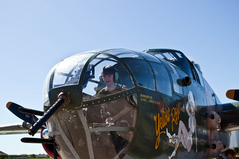 A Young Nose Gunner and Bombardier (4/25/2010)<br /> <br /> My youngest son and I went to a local commemorative airplane display yesterday.   Here he is imagining he was flying, in nose gunner position.  This is a fully functional B-25, the Yellow Rose. <br /> Thank you for all your park bench comments yesterday,Have a great Sunday.