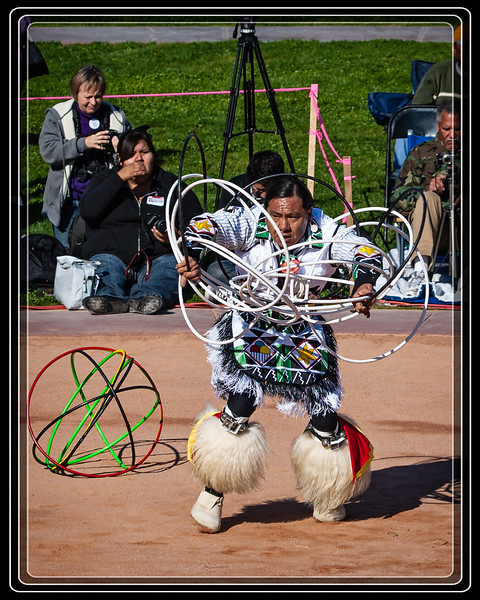 He is using two different hoop colors.  He must maintain balance not only in design for the hoops but for each of the colors.    Link to Photo Without Frame