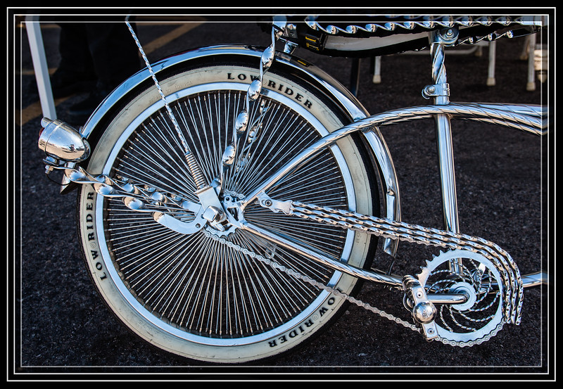"""Low Rider 2 Wheel Style Approximately 160 Spokes on the Wheel.  </font> <a href=""""http://www.rickwillis-photos.com/Events/Recurring/Car-Vehicle-Shows/27524312_HFxNgN#!i=2399881470&k=s3RrdNf""""> <font color=""""Aqua""""> Car Show Here </a> </font>  </font> <a href=""""http://www.rickwillis-photos.com/Portfolio/Best/Hidden-Photos-Without-Frames/26709550_DZD78d#!i=2399472995&k=vX9RHRt""""> <font color=""""Red""""> Link to Photo Without Frame </a> </font>"""