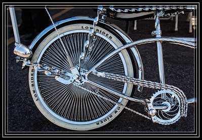 Low Rider 2 Wheel Style Approximately 160 Spokes on the Wheel.     Car Show Here       Link to Photo Without Frame