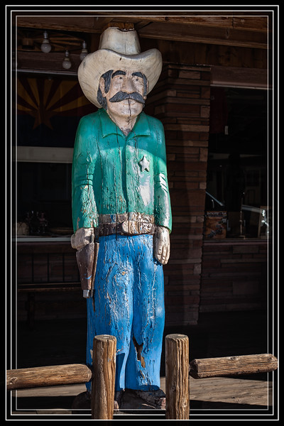 """The Sheriff  has a Supporting Role for this Establishment's Porch.  </font> <a href=""""http://www.rickwillis-photos.com/Portfolio/Best/Hidden-Photos-Without-Frames/26709550_DZD78d#!i=2479138156&k=QXwhjnN""""> <font color=""""Red"""">Link to Photo Without Frame</a> </font></a></font>"""