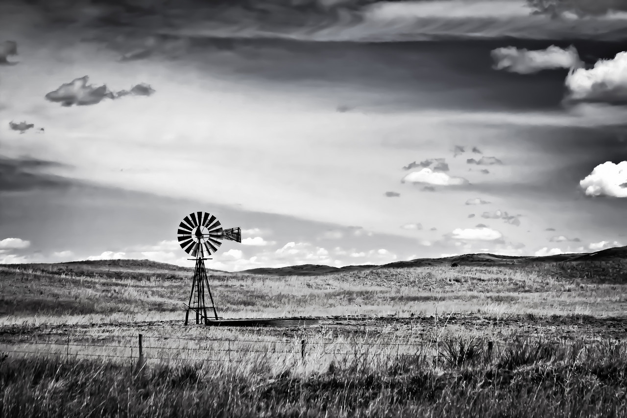 Old #4 - Windmill on the Nebraska plains<br /> This particular windmill has a 4 painted on it I wonder how many there are.  <br /> The Nebraska Sandhills is the place to be for windmill spotting.