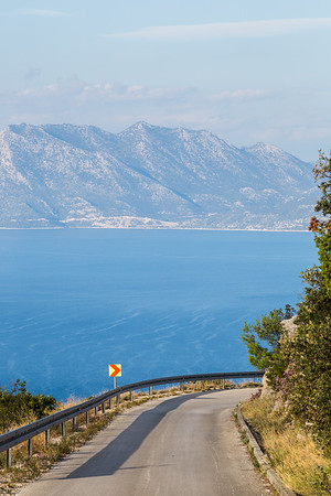 Road slopes down towards the Adriatic