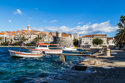 Boats bob on the choppy waters by Korcula old town