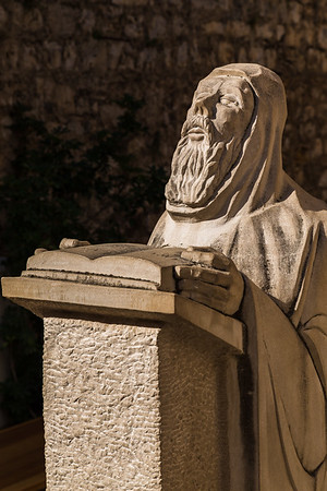 Statue of St Anthony reading from the bible