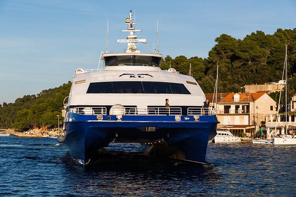 Catamaran slows as it approaches Mljet