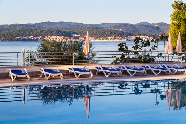 Overlooking a swimming pool towards Korcula old town