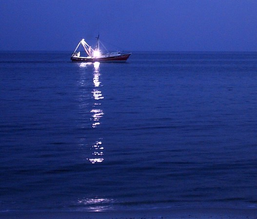 Fishing boat at dusk.