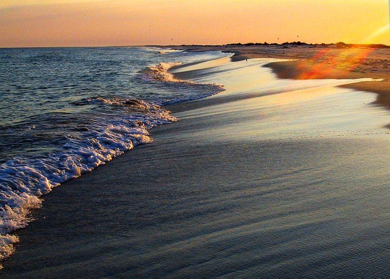 Sunset on surf.