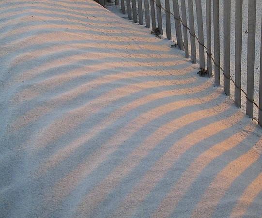 Evening sun on the beach and sand of Dauphin Island.