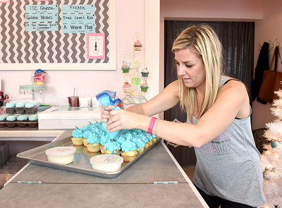 "KRISTIN BAUER | CHRONICLE          Holly Kennedy, owner and baker at Cupcake Wishes, puts the finishing touches on a batch of Frozen-themed cupcakes on Saturdy afternoon, Dec. 12 for the  ""Frozen"" Fun Day to raise money for those battling childhood cancer."