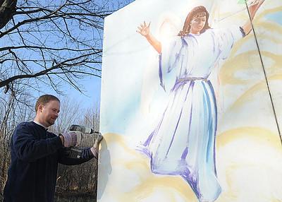 Pastor Josh Moldenhauer of Grace Lutheran Church, helps construct a live nativity scene at Grace Lutheran Church in Oberlin on Dec. 7.  STEVE MANHEIM/CHRONICLE
