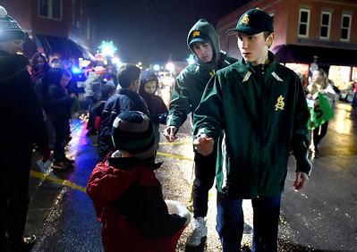 The Amherst Steele High School baseball team passes out candy at the Miracle on Main Street Parade on Dec. 5. KRISTIN BAUER | CHRONICLE