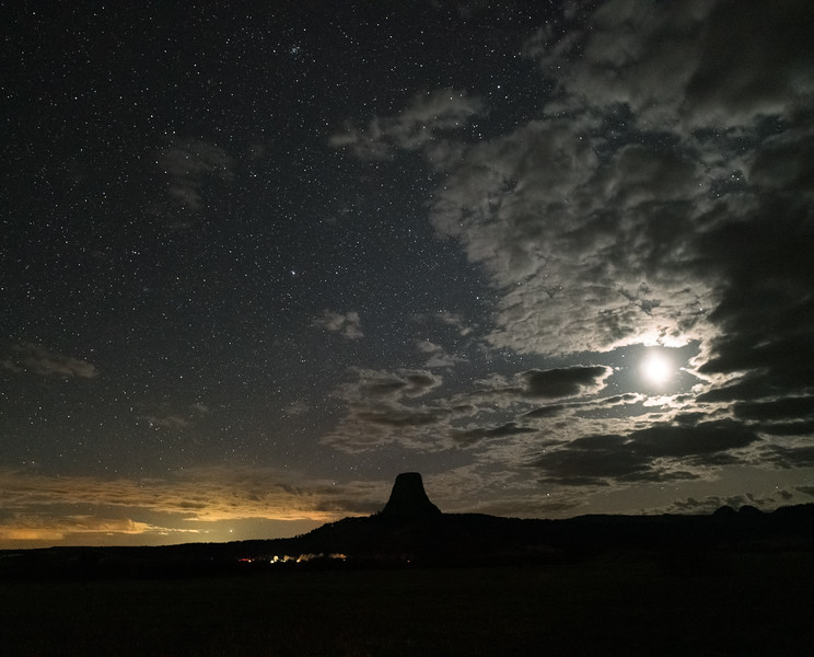 Space X Starlink satellite train passes by Devils Tower, Wyoming